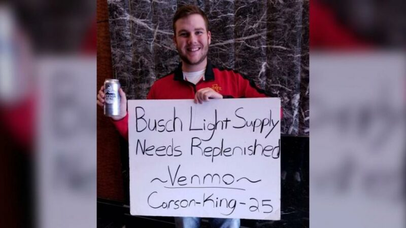 A college football fan's sign asking for beer money raised more than $1 million